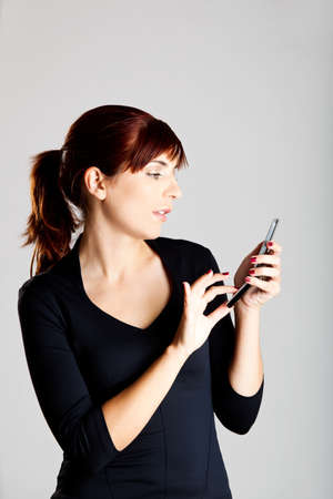 Portrait of a beautiful and attractive young woman sending a text message photo