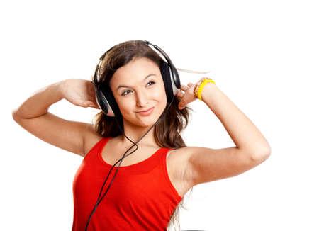 Beutiful girl listen music isolated on white Stock Photo - 7150282