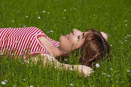 Young woman relaxing on a beautiful green meadow Stock Photo - 7199945