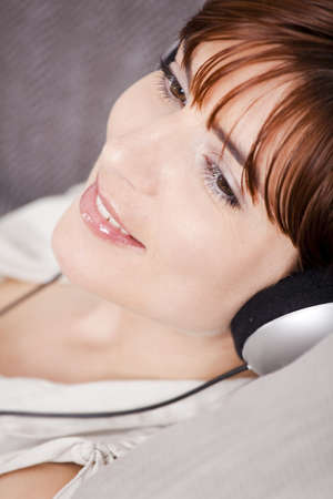 Portrait of a young woman listening music with headphones photo