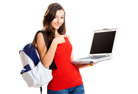 Beautiful young female student showing something on a laptop, isolated on white Stock Photo - 7636764