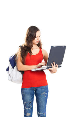 Beautiful young female student with a laptop, isolated on white Stock Photo - 7750717