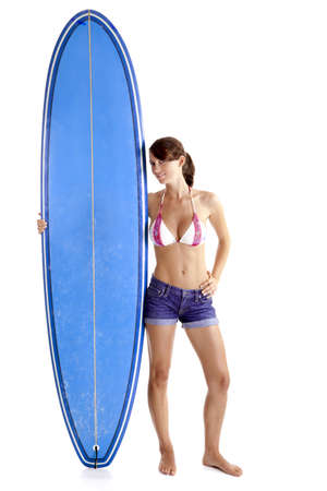 causal: Beautiful young woman posing with a surfboard, isolated on white