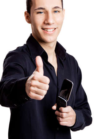 Casual young man with thumbs up, isolated on white photo
