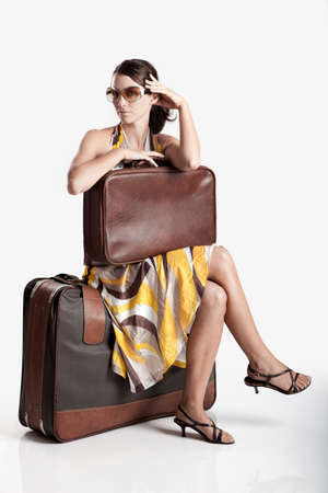 Beautiful young fashion woman posing with a old suitcase Stock Photo - 7954996