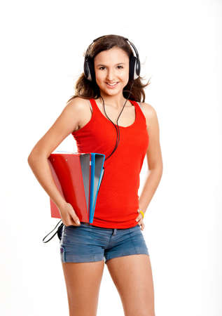 Beautiful girl listen music and holding some cases, isolated on white photo