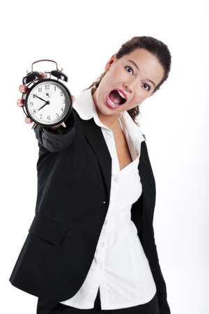 Portrait of Young and beautiful businesswoman holding a clock; focus is on the clock photo