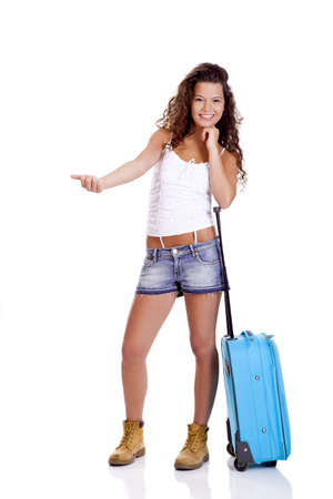 Beautiful young woman carrying a blue suitcase, isolated on white background photo
