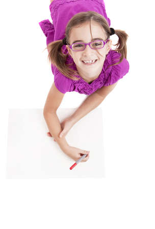 Girl lying on floor and making drawings on paper  photo