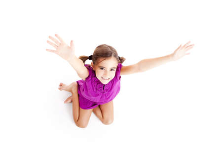 Top view of a happy girl sitting on floor with arms open Stock Photo - 8210656