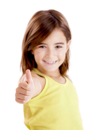Portrait of a beautiful and confident girl showing thumbs up isolated one white photo