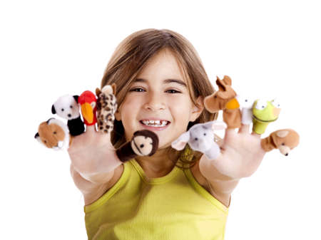 Cute and happy girl playing with finger puppets photo
