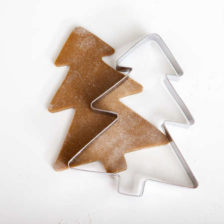 cookie cutters: Baking homemade Gingerbread cookies with a shape of a christmas tree