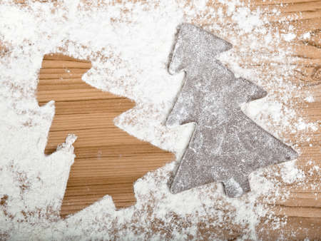 Baking homemade Gingerbread cookies with a shape of a christmas tree photo
