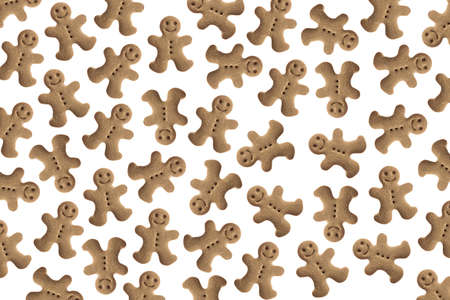 Background made with tens of homemade gingerbread man cookies photo