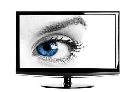 Modern HD TV showing a beautiful female blue eye. photo