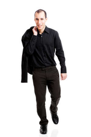 Young man with a casual business look walking, isolated on white Stock Photo - 8407439