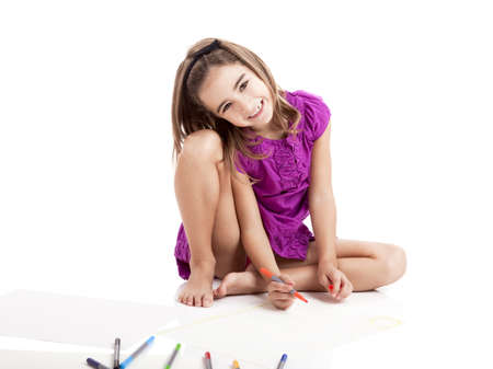 Girl sitting on floor and making drawings on paper Stock Photo - 8458442