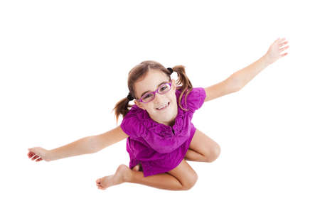 Top view of a happy girl sitting on floor with arms open  photo
