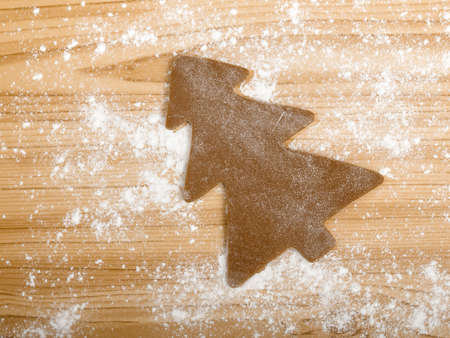 Baking homemade Gingerbread cookies with a shape of a christmas tree Stock Photo - 8458485