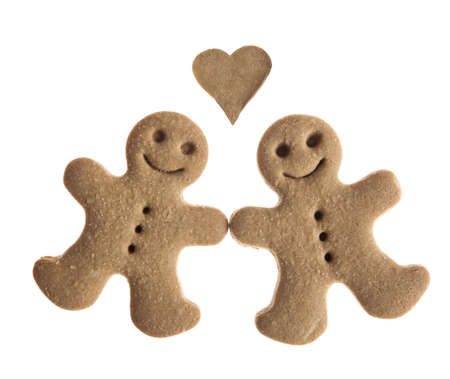 Homemade Gingerbread man cookies isolated on white background photo