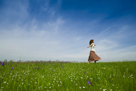 woman dancing: Young woman dancing on a beautiful green meadow