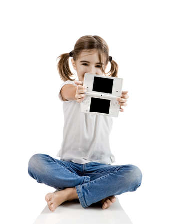 videogame: Little girl sitting on floor playing a video-game