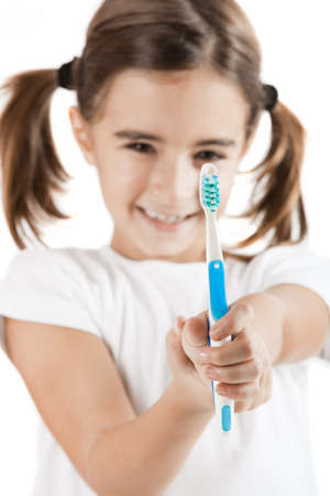 portrait of a pretty Little girl holding a toothbrush photo