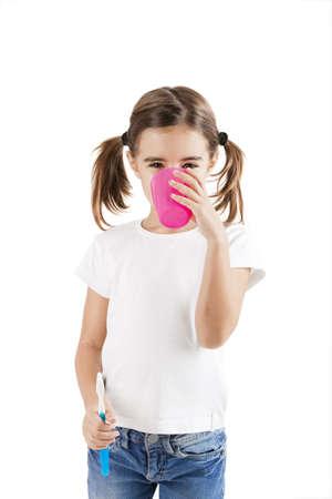Little girl brushing teeth isolated on white background photo