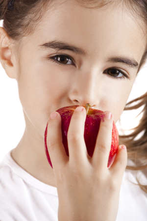 Portrait of a beautiful little girl eating a red apple Stock Photo - 8875993