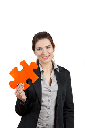 Business woman holding a big puzzle piece, isolated on white photo