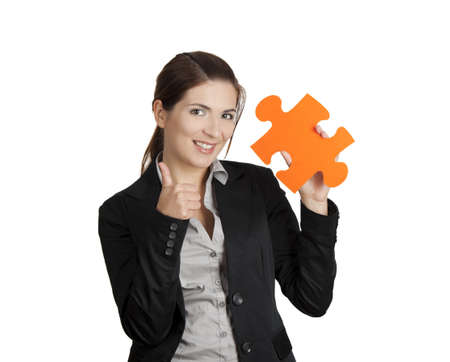 Happy business woman with thumbs up and holding a big piece of puzzle, isolated on white photo