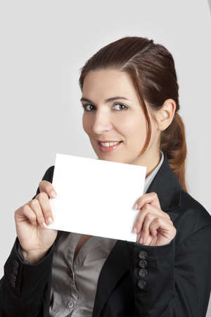 Beautiful business woman holding a blank card Stock Photo - 8875985