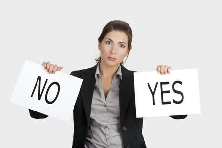 Business young woman trying to make a decision between Yes or No choice photo