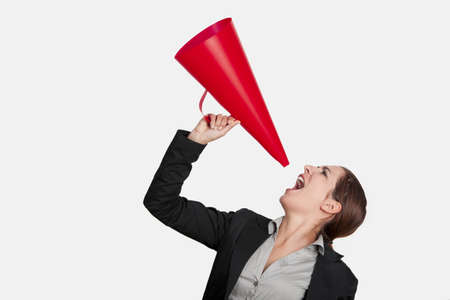loudspeaker: Business young woman speaking to a megaphone, isolated on white Stock Photo