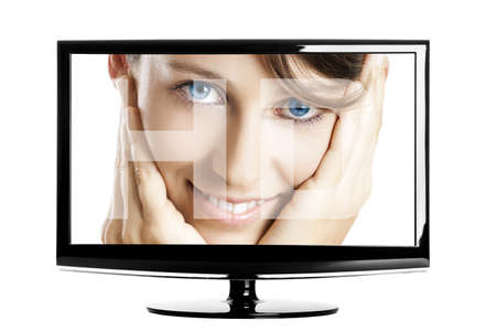 Modern HD TV showing a beautiful young woman smiling. photo