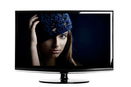 Modern lcd TV showing a beautiful young woman smiling. photo