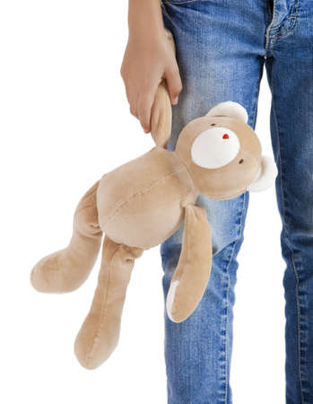 Little kid alone with her teddy bear, isolated on white Stock Photo - 8990110