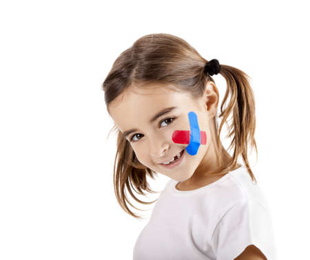 Little girl with bandage on the face, isolated on white photo