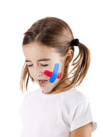 Sad little girl with bandage on the face, isolated on white photo