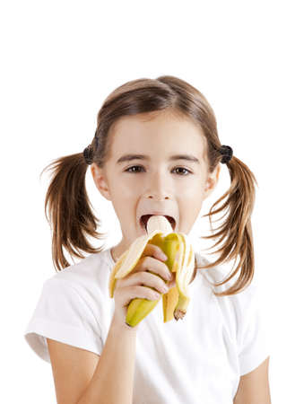 Portrait of a beautiful little girl eating a banana Stock Photo - 8990088