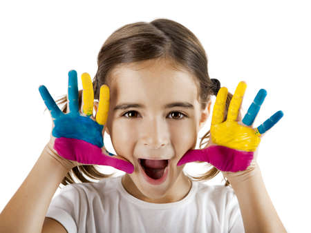 Little girl making a funny face with both hands painted photo