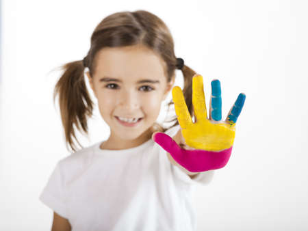Little girl with hand painted, focus is on he hand photo