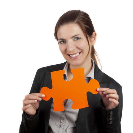 Business woman holding a big puzzle piece, isolated on white Stock Photo - 8990031