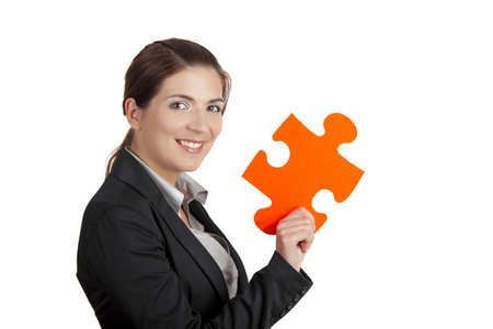 connections: Business woman holding a big puzzle piece, isolated on white