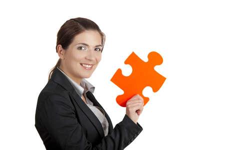 conexiones: Mujer de negocios con una pieza de gran rompecabezas, aislada en blanco Foto de archivo