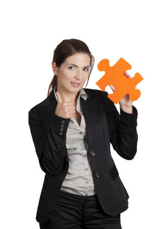 Happy business woman with thumbs up and holding a big piece of puzzle, isolated on white Stock Photo - 8990039