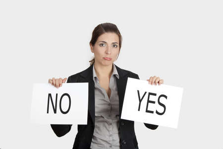 Business young woman trying to make a decision between Yes or No choice Stock Photo - 8990038