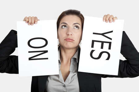 no problems: Business young woman trying to make a decision between Yes or No choice Stock Photo