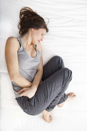 Young girl in pain with PMS, Premenstural Syndrome Stock Photo - 9111972